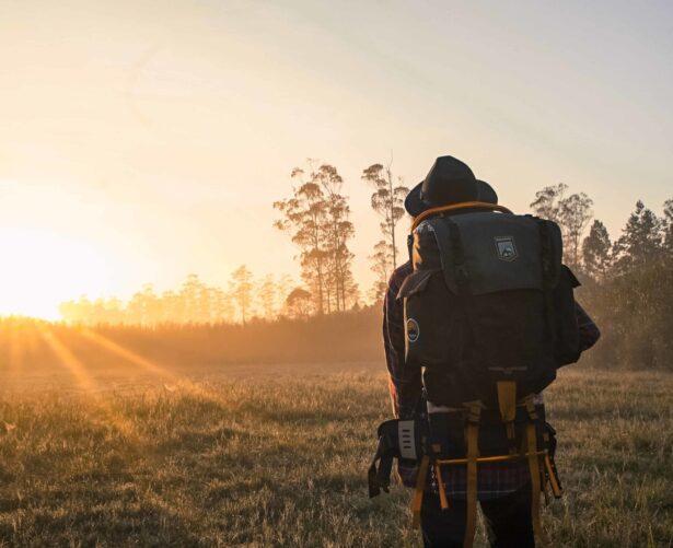 backpacker watching sunset
